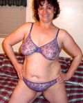 Sex Kitten In Purple Lingerie